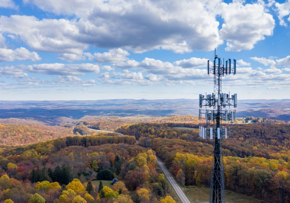 Aerial view of mobiel phone cell tower over forested rural area of West Virginia to illustrate lack of broadband internet service